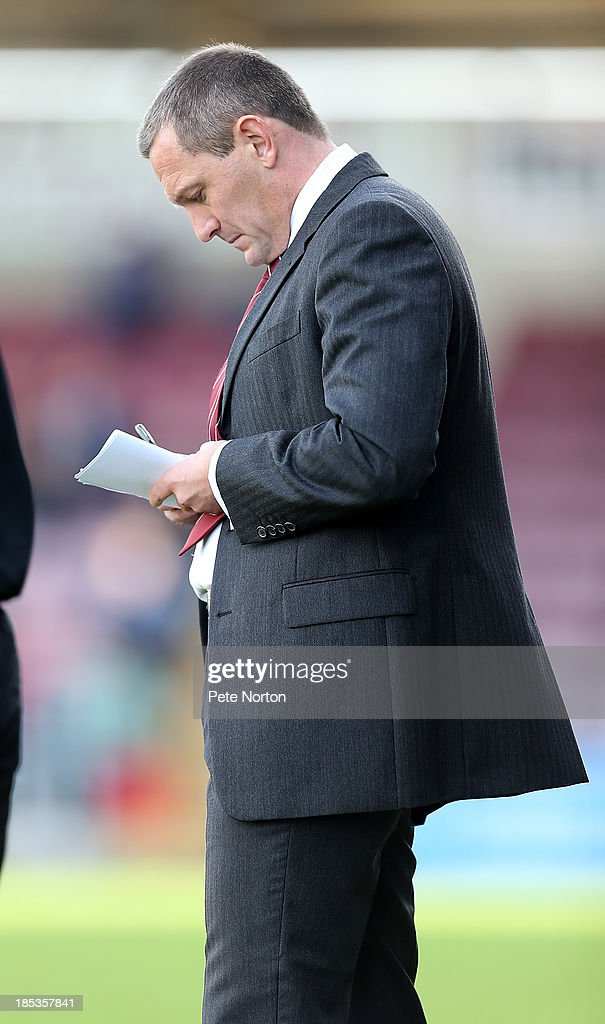 Northampton Town manager Aidy Boothroyd makes notes during the Sky Bet League Two match between Northampton Town and Dagenham & Redbridge at Sixfields Stadium on October 19, 2013 in Northampton, England.