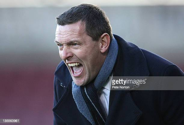 Northampton Town manager Aidy Boothroyd shouts instructions during the npower League Two match between Northampton Town and Crewe Alexandra at...