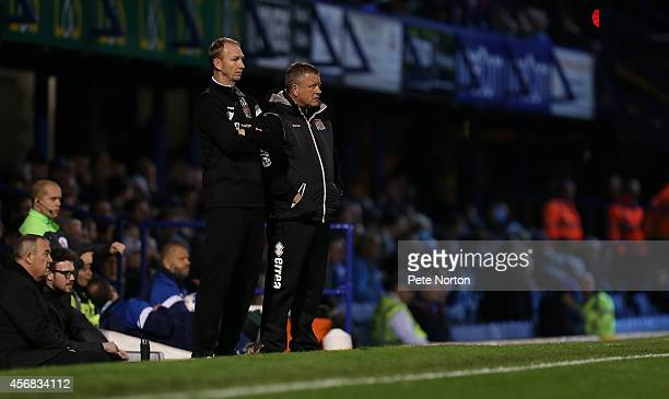 Northampton Town manager Chris Wilder and assistant manager Alan Knill look on during the Johnstone's Paint Trophy Southern Section Second Round...
