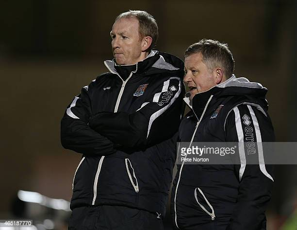 Northampton Town manager Chris Wilder and assistant manager Alan Knill look on during the Sky Bet League Two match between Northampton Town and...