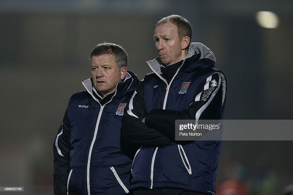 Northampton Town Manager Chris Wilder and his assistaint Alan Knill (r) look on during the Sky Bet League Two match between Northampton Town and Carlisle United at Sixfields Stadium on March 17, 2015 in Northampton, England.