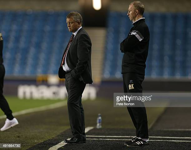 Northampton Town manager Chris Wilder and his assistant Alan Knill look on during the Johnstone's Paint Trophy match between Millwall and Northampton...
