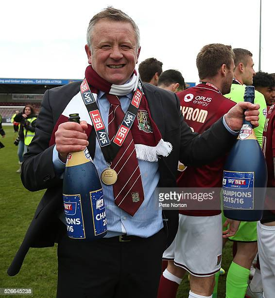 Northampton Town manager Chris Wilder celebrates with champagne after Sky Bet League Two match between Northampton Town and Luton Town at Sixfields...
