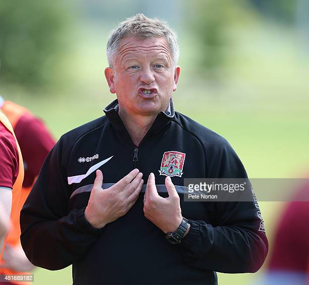 Northampton Town manager Chris Wilder gives instructions during a training session at Moulton College on July 4 2014 in Northampton United Kingdom