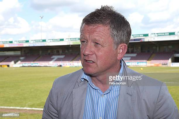 Northampton Town manager Chris Wilder looks on during a photo call to announce the signing of Marc Richards at Sixfields on May 14 2014 in...