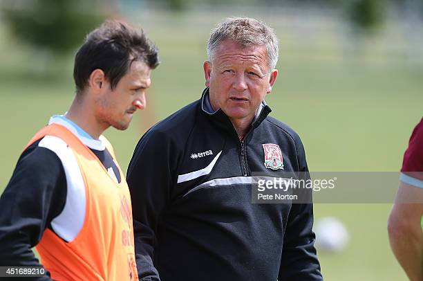 Northampton Town manager Chris Wilder looks on during a training session at Moulton College on July 4 2014 in Northampton United Kingdom