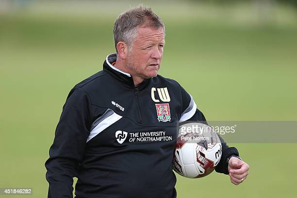 Northampton Town manager Chris Wilder looks on during a training session at Moulton College on July 8 2014 in Northampton United Kingdom