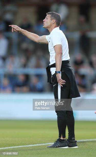 Northampton Town manager Dean Austin gives instructions during the Carabao Cup First Round match between Wycombe Wanderers and Northampton Town at...