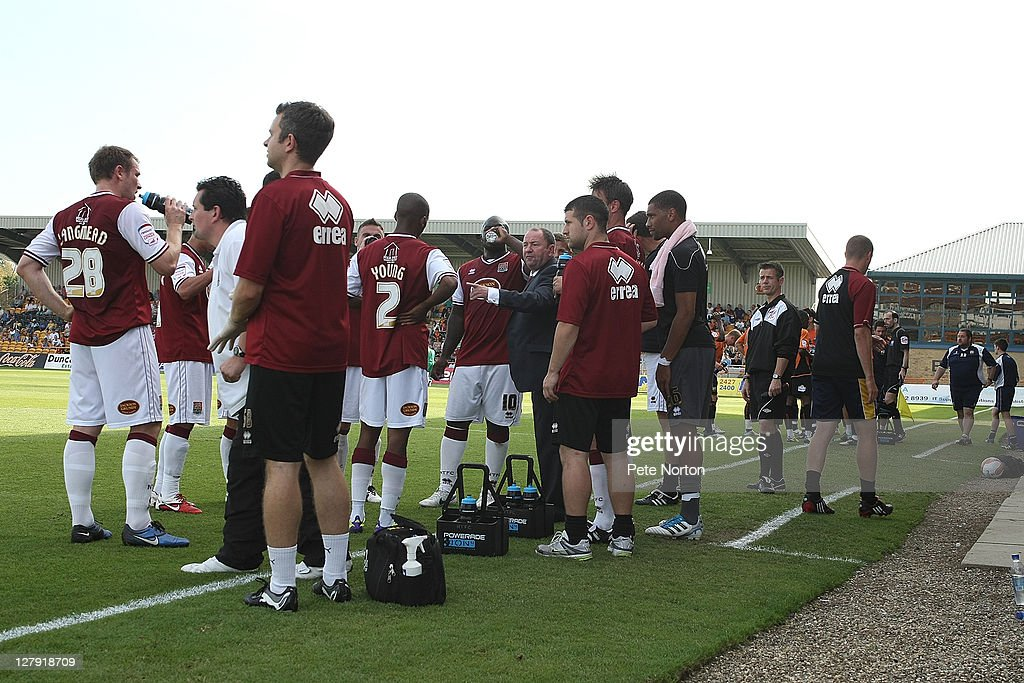 Northampton Town manager Gary Johnson gives his players instructions as they take drinks during the npower League two match between Barnet and Northampton Town at Underhill Stadium on October 1, 2011 in Barnet, England.