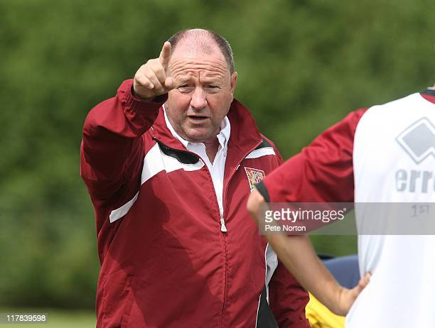 Northampton Town manager Gary Johnson gives instructions during a training session at Moulton College on June 29 2011 in Northampton England