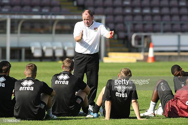 Northampton Town manager Gary Johnson talks to his players during a training session at Sixfields Stadium on September 30 2011 in Northampton England