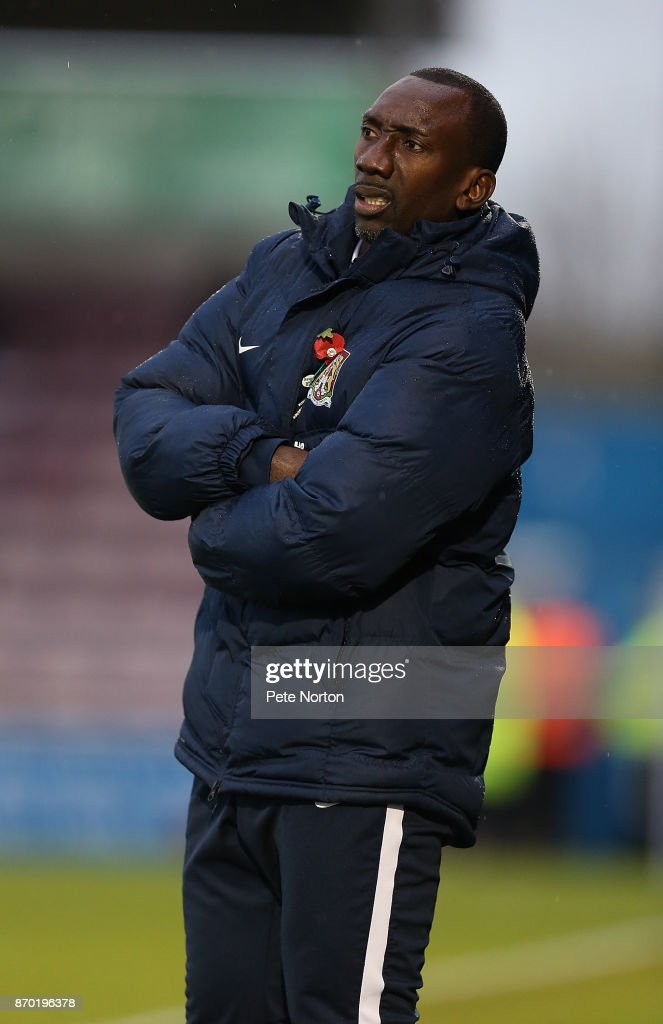 Northampton Town manager Jimmy Floyd Hasselbaink looks on during The Emirates FA Cup First Round match between Northampton Town and Scunthorpe United at Sixfields on November 4, 2017 in Northampton, England.