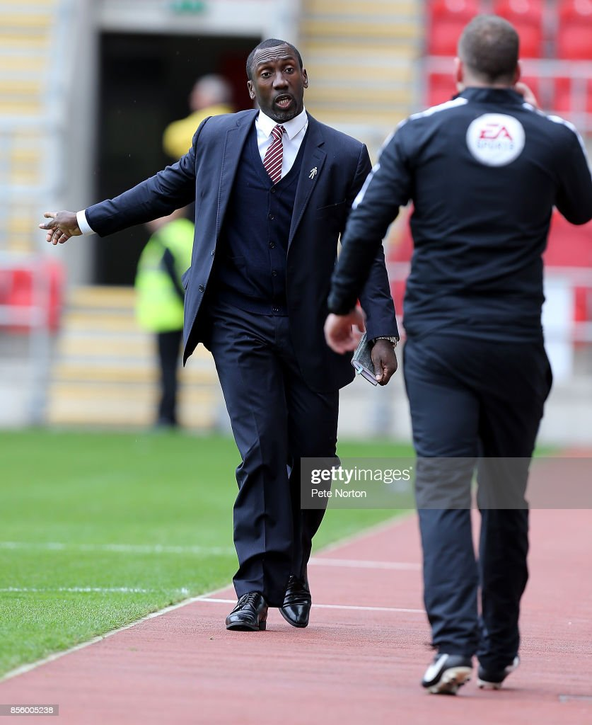 Northampton Town manager Jimmy Floyd Hasselbaink makes a point to fourth official Paul Newhouse during the Sky Bet League One match between Rotherham United and Northampton Town at The Aesseal New York Stadium on September 30, 2017 in Rotherham, England.