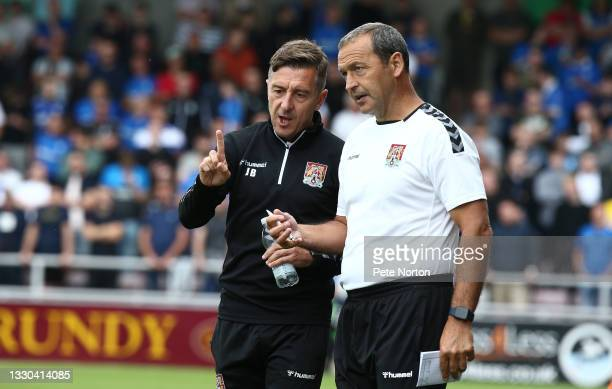 Northampton Town manager Jon Brady makes a point to his assistant Colin Calderwood during the pre-Season Friendly match between Northampton Town and...