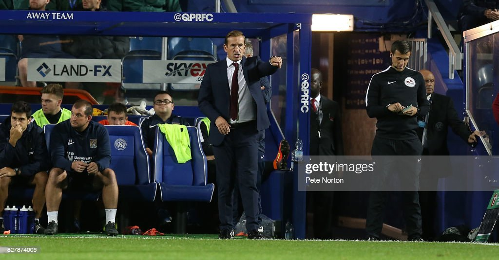 Northampton Town manager Justin Edinburgh gives instructions during the Carabao Cup first round match between Queens Park Rangers and Northampton Town at Loftus Road on August 8, 2017 in London, England.