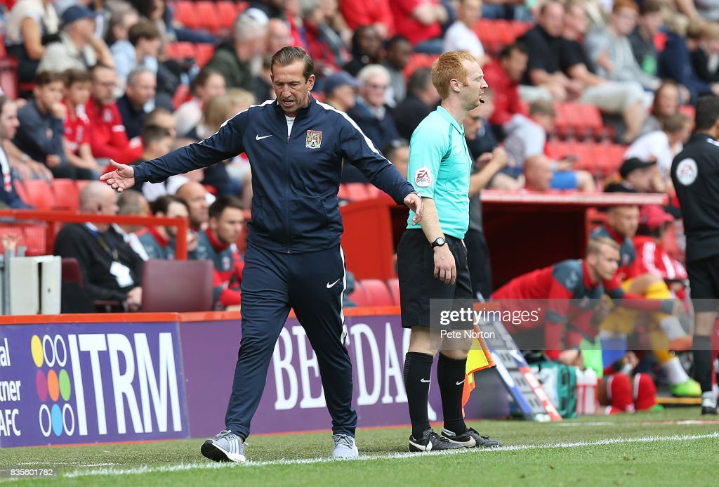Northampton Town manager Justin Edinburgh walks the touchline animated during the Sky Bet League One match between Charlton Athletic and Northampton Town at The Valley on August 19, 2017 in London, England.