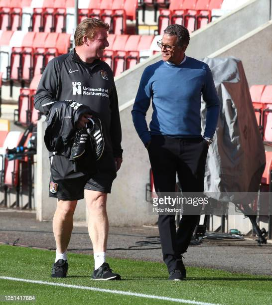 Northampton Town manager Keith Curle talks to one of his coaches Ronnie Jepson prior to the Sky Bet League Two Play Off Semifinal 2nd Leg match...