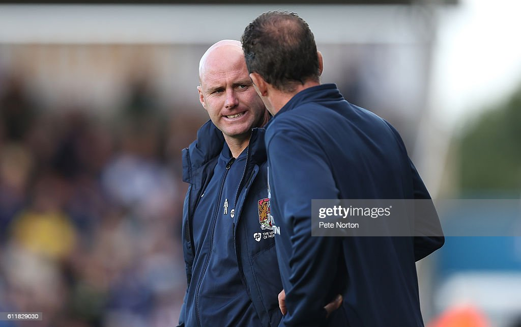 Northampton Town manager Rob Page looks to assistant Paul Wilkinson during the Sky Bet League One match between Northampton Town and Bristol Rovers at Sixfields Stadium on October 1, 2016 in Northampton, England.