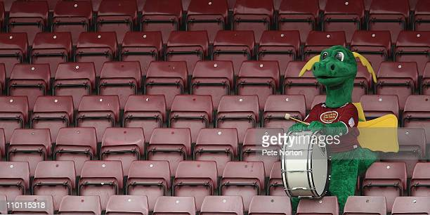 Northampton Town mascot Clarence the Dragon looks on from an empty stand during the npower League Two match between Northampton Town and Macclesfield...