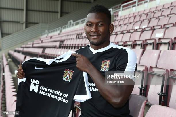 Northampton Town new signing Aaron Pierre poses with a shirt during a photo call at Sixfields on July 21 2017 in Northampton England