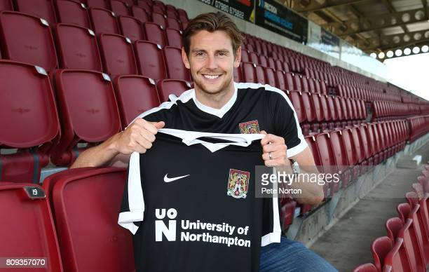 Northampton Town new signing Ash Taylor poses with a shirt during a photo call at Sixfields on July 5 2017 in Northampton England