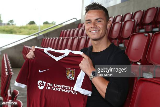 Northampton Town New Signing Billy Waters poses with a shirt during a photo call at Sixfields on June 8 2017 in Northampton England