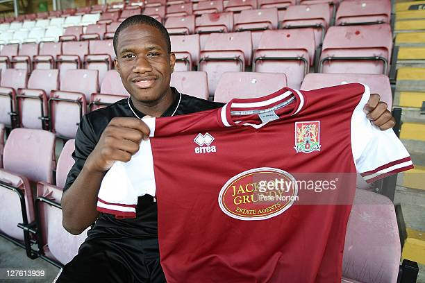Northampton Town new signing Chris Arthurs poses with a shirt during a photo call at Sixfields Stadium on September 30 2011 in Northampton England