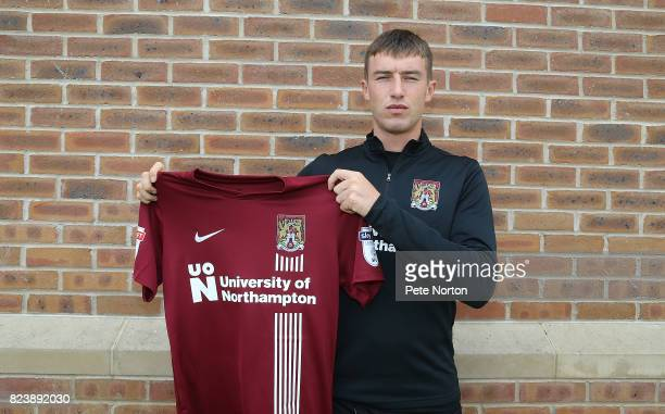 Northampton Town new signing Chris Long poses with a shirt during a photo call at Sixfields on July 28 2017 in Northampton England