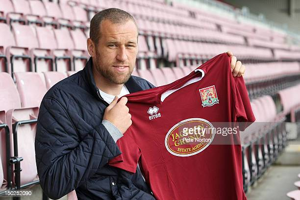Northampton Town new signing David Artell poses with a shirt during a photo call at Sixfields on August 13 2012 in Northampton England