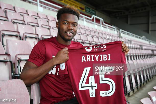 Northampton Town new signing Gboly Ariyibi poses with a shirt during a photo call at Sixfields on January 19 2018 in Northampton England