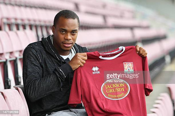 Northampton Town new signing Ishmel Demontagmac poses with a shirt during a press conference at Sixfields Satdium on June 27 2012 in Northampton...