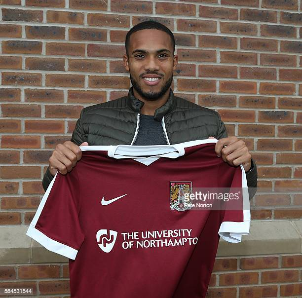 Northampton Town new signing Kenji Gorre poses with a shirt at Moulton College on July 29 2016 in Northampton England