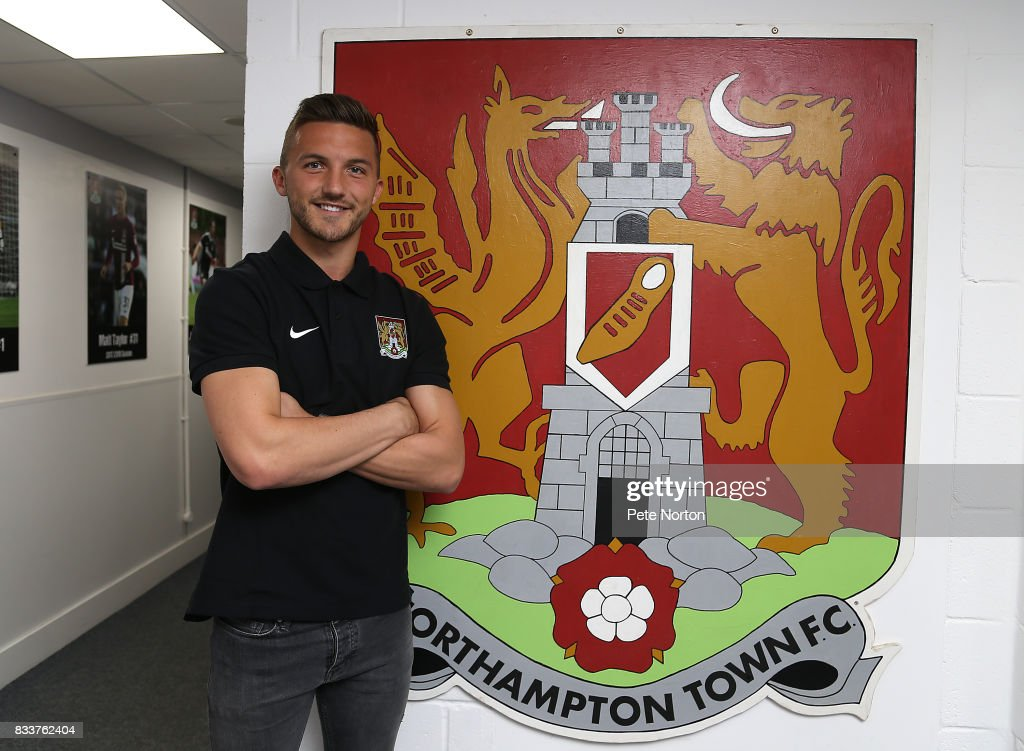 Northampton Town new signing Luke Coddington poses during a photo call at Sixfields on August 17, 2017 in Northampton, England.