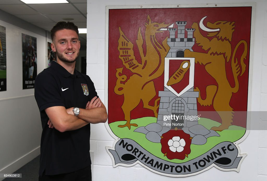 Northampton Town new signing Matt Grimes poses during a photo call at Sixfields on August 18, 2017 in Northampton, England.
