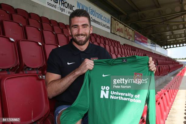 Northampton Town new signing Matt Ingram poses with a shirt during a photo call at Sixfields on August 31 2017 in Northampton England