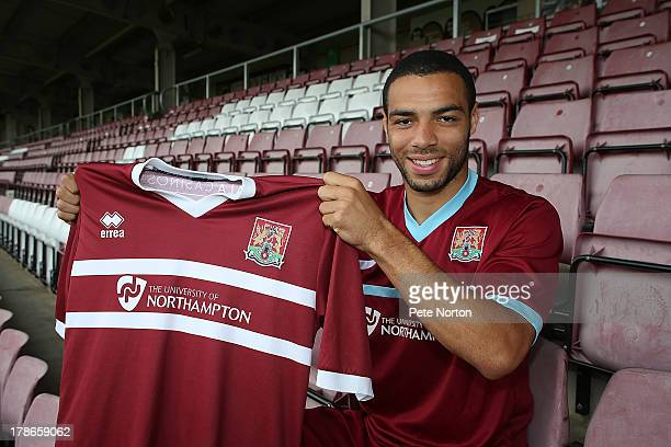 Northampton Town new signing Matthew Harriott poses with a shirt during a photo call at Sixfields Stadium on August 30 2013 in Northampton England