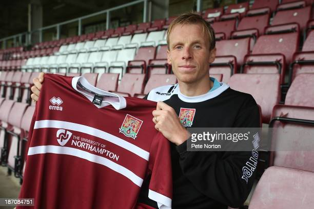 Northampton Town new signing Ricky Ravenhill poses with a shirt during a photo call at Sixfields Stadium on November 6 2013 in Northampton England