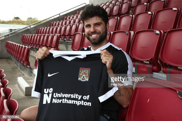 Northampton Town new signing Yaser Kasim poses with a shirt in the stands at Sixfields on July 4 2017 in Northampton England