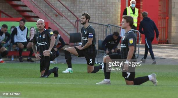 Northampton Town players Alan McCormack and Charlie Goode take a knee prior to kick off during the Sky Bet League Two Play Off Semifinal 2nd Leg...
