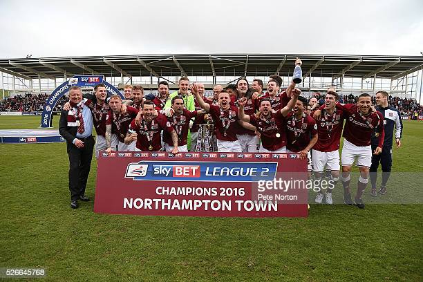 Northampton Town players celebrate after recieving the Sky Bet League Two champions trophy after Sky Bet League Two match between Northampton Town...