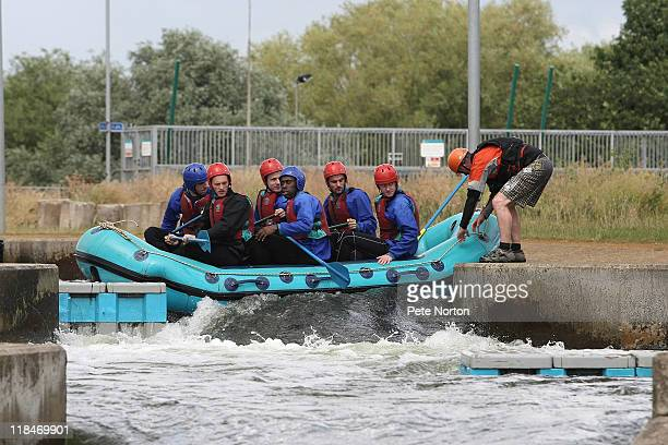 Northampton Town players get their raft stuck during a training session at Nene Whitewater Centre on July 7, 2011 in Northampton, England.