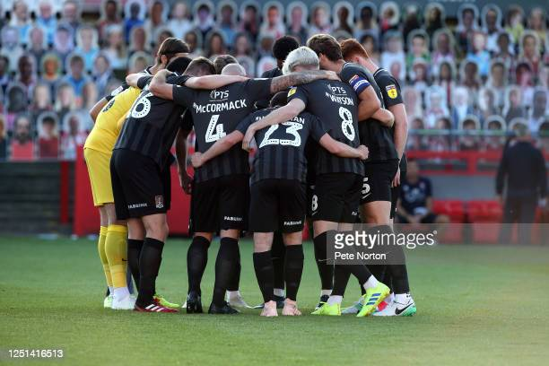 Northampton Town players Huddle prior to kick off during the Sky Bet League Two Play Off Semifinal 2nd Leg match between Cheltenham Town and...