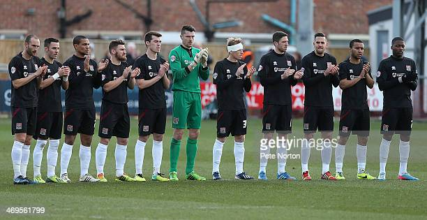 Northampton Town players observe a minutes applause to the memory of Sir Tom Finney prior to the Sky Bet League Two match between Fleetwood Town and...