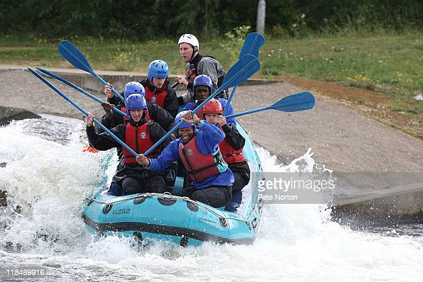 Northampton Town players steer their raft over the rapids during a training session at Nene whitewater Centre on July 7, 2011 in Northampton, England.