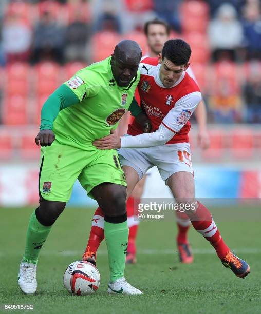 Northampton Town's Adebayo Akinfenwa battles with Rotherham United's Mark Bradley during the npower Football League Two match at the New York Stadium...