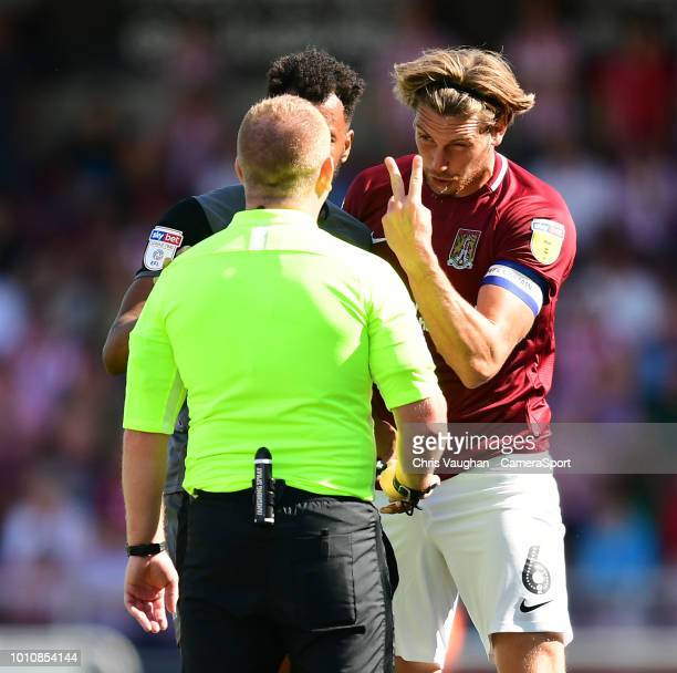 Northampton Town's Ash Taylor argues a point with Referee Lee Swabey during the Sky Bet League Two match between Northampton Town and Lincoln City at...