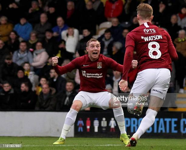 Northampton Town's Nicky Adams celebrates scoring his side's first goal of the game with teammate Ryan Watson Burton Albion v Northampton Town FA Cup...