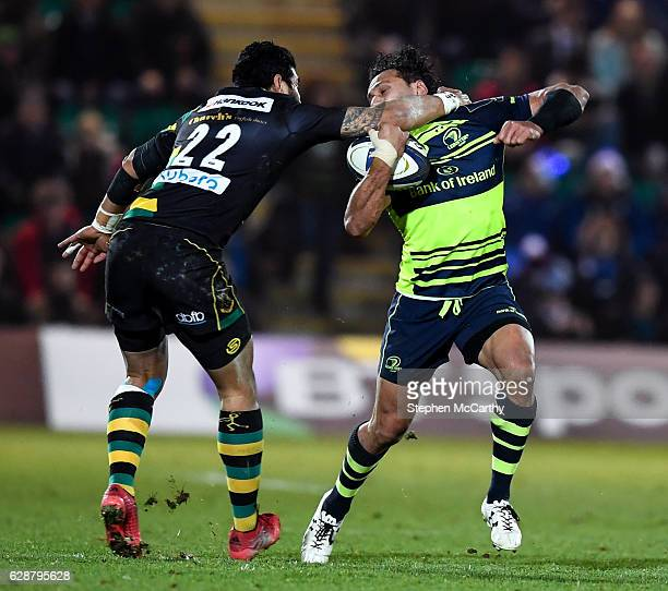 Northampton United Kingdom 9 December 2016 George Pisi of Northampton Saints puts in a high tackle on Isa Nacewa of Leinster during the European...