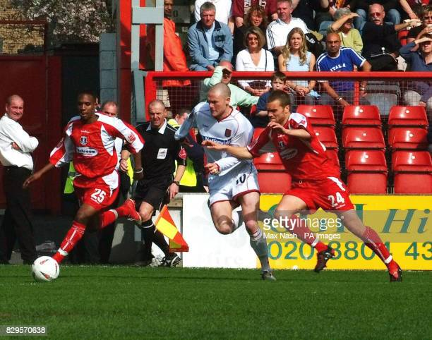 Northampton's Andy Kirk tries to avoid a tackle from Leyton Orient's Aiden Palmer and Daryl McMahon