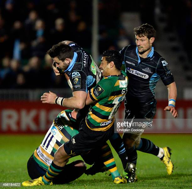 Northampton's George North and George Pisi stop Glasgow's Tommy Seymour at Scotstoun Stadium on November 21 2015 in Glasgow Scotland